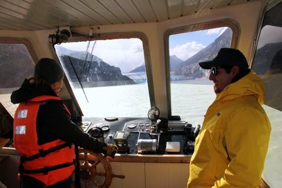 Anne Howard driving a ship through a glacier field