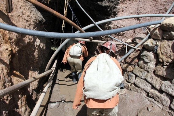 Geared up for the mine with rubber suits, wellies, miners helmets, headlamps and battery belts Potosi Bolivia