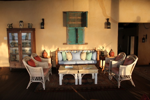 Medjumbe's décor had a hint of Arab, African, Portuguese flair. Antique lanterns, weathered wood furniture, African pottery, and sea-glass colored pillows all mixed for a sexy coastal vibe.