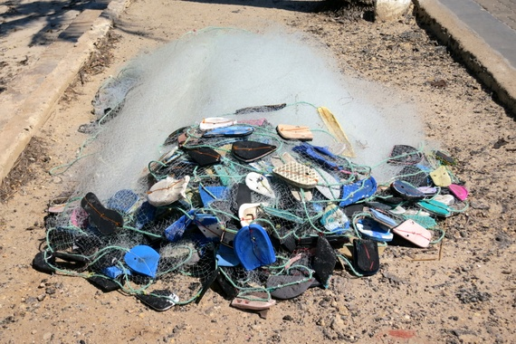 Mozambique fishermen are your best beach clean-up crew...using washed-up flip-flops as buoys for their fishing nets