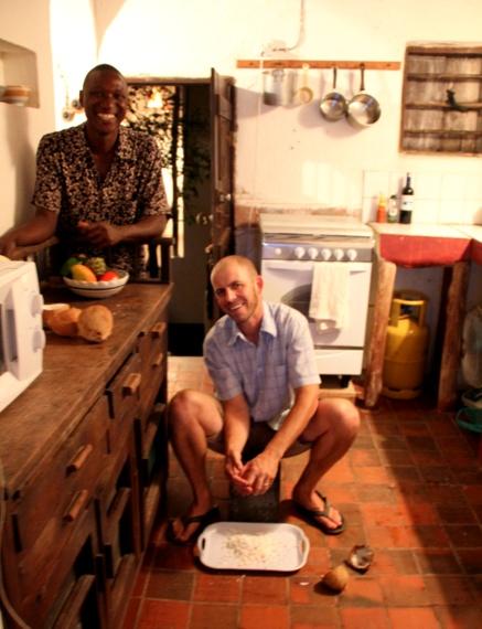 Mike using the mbuzi to shred coconut Lamu Kenya