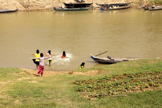 local kids swimming in battambang