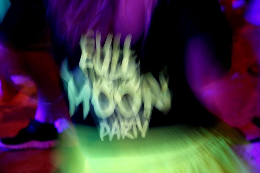 black light full moon party sign