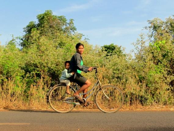 Cambodian mom on bike