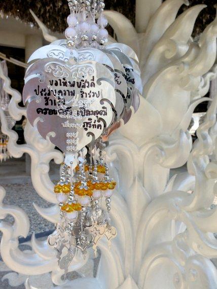 Prayers at White Temple Chiang Rai