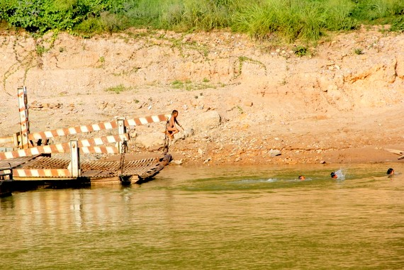 Kids Swimming in Laos